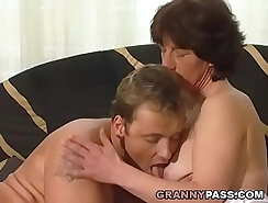 Black granny with hairy pussy is sucking hard cock inside the bike