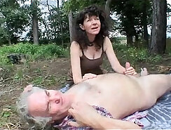 Anal loving mature couple making love outdoors