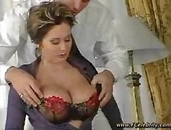 Captivating juggs boss is using ultra hot and horny sex dolls on a bed
