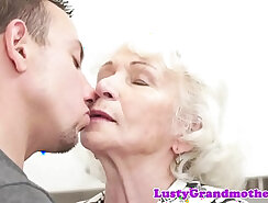 Asian European grandma showing off her huge